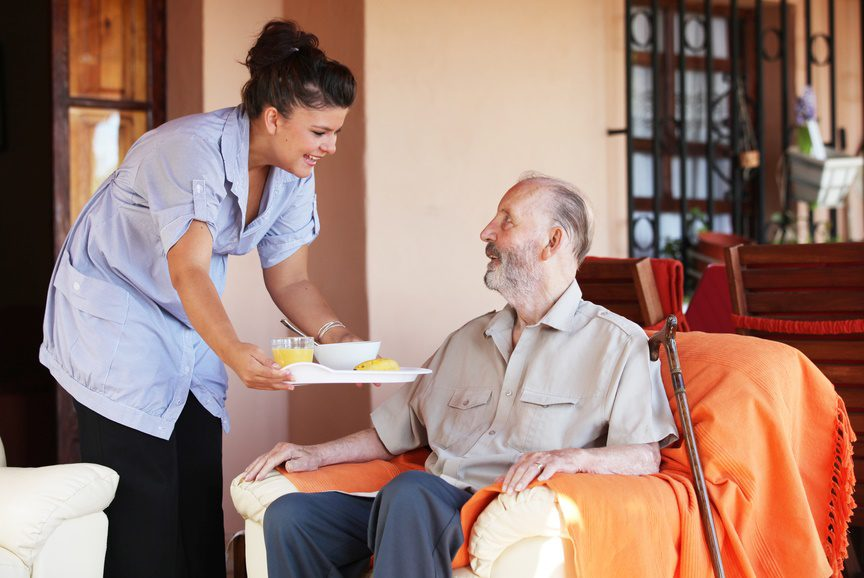 home caregiver assists senior
